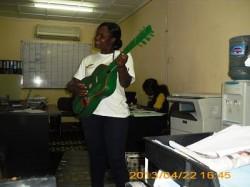 Nyarai trying to play the guitar