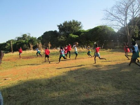 The girls(in red) during a friendly match against David Livingstone College of Education