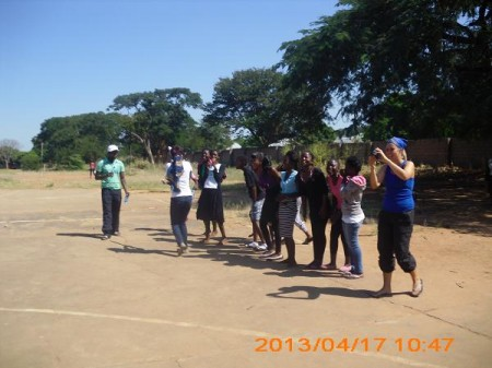 Sports Faciltation officer Steve and the YSEP volunteer from Norway Theresa with the girls  doing outdoor activities during the workshop
