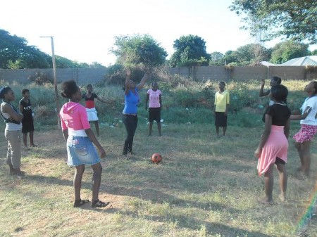 YSEP volunteer from Zimbabwe, Nyarai in the middle with the girls during a volleyball training session