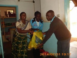 A guidance teacher from Livingstone Basic school donates washing paste on behalf of the girls as a way of supporting the home