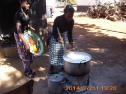 The older girls preparing Nshima for Lunch