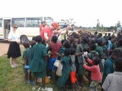 Travellers interacting with the children at Choma Airport Community School