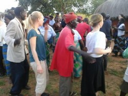Travellers join in the dancing upon arrival at Tusime Community School