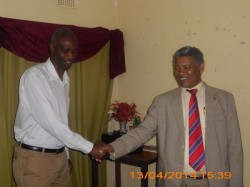 Response Network Assistant Country Director Mr Mutukwa Matengenya (L) and Response Board Chairman Hon. Given Lubinda shaking hands after a little chat at the office Board room.