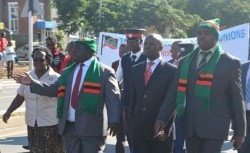 (Left to right) Livingstone town clerk, Communications and transport minister Yamfwa Mukanga(in a Zambia branded headsock) and Livngstone District Commissioner Omar Munsanje
